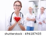 doctor with stethoscope holding ... | Shutterstock . vector #696187435