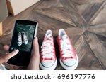 online seller use mobile phone...   Shutterstock . vector #696197776