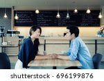 dating in a cafe. beautiful... | Shutterstock . vector #696199876