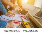 architect man working with... | Shutterstock . vector #696205135
