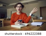 portrait of confused hipster... | Shutterstock . vector #696222388