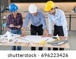 architect team meeting on... | Shutterstock . vector #696223426