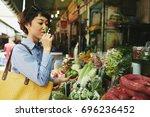 japanese pretty woman shopping... | Shutterstock . vector #696236452