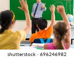 all the pupils rising hands as... | Shutterstock . vector #696246982