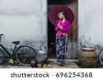 beautiful woman wearing nyonya...   Shutterstock . vector #696254368