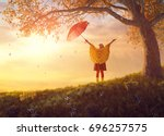 happy funny child with red... | Shutterstock . vector #696257575