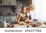 happy family mother and child... | Shutterstock . vector #696257986