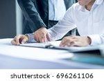 business people teach new... | Shutterstock . vector #696261106
