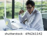 young businessman sitting at... | Shutterstock . vector #696261142