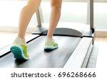 leg of woman running on... | Shutterstock . vector #696268666
