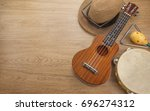 close up brown ukulele  straw... | Shutterstock . vector #696274312