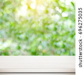 empty white wooden table over... | Shutterstock . vector #696275035