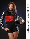 young sexy girl in a racing suit | Shutterstock . vector #696303478