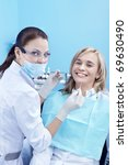 A patient at a reception at the dentist - stock photo