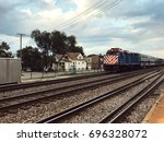 cargo train platform at sunset. ... | Shutterstock . vector #696328072