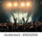 concert crowd attending a... | Shutterstock . vector #696332926