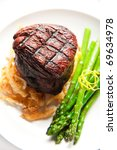 Thick Filet mignon served with crispy onions and asparagus - stock photo