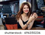 smiling woman with red lips in... | Shutterstock . vector #696350236