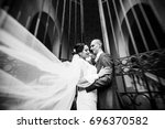 wedding couple walking in the... | Shutterstock . vector #696370582