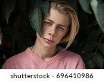 conceptual closeup portrait of...   Shutterstock . vector #696410986