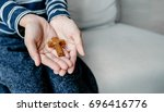 give the wooden cross with...   Shutterstock . vector #696416776