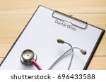 stethoscope and clipboard with... | Shutterstock . vector #696433588