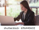 business lady pondering over... | Shutterstock . vector #696440632