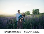 young couple enjoying the... | Shutterstock . vector #696446332
