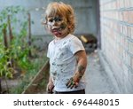 painted face of child. little... | Shutterstock . vector #696448015