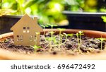 wood home model with young... | Shutterstock . vector #696472492