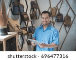 shop owner using tablet pc at... | Shutterstock . vector #696477316