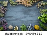 medicinal herbs bunches on gray ... | Shutterstock . vector #696496912