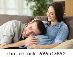 father hearing his son kicking... | Shutterstock . vector #696513892