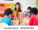 asian female teacher teaching... | Shutterstock . vector #696535582