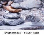 pile of stones along river in... | Shutterstock . vector #696547885