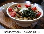 mushroom salad with egg onsen... | Shutterstock . vector #696551818