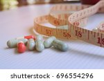slimming concept  slim pill | Shutterstock . vector #696554296