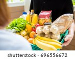 delivery man in black uniform... | Shutterstock . vector #696556672