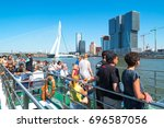 Small photo of Rotterdam, The Netherlands - July 18, 2016: A boat with tourists crossing the Maas river