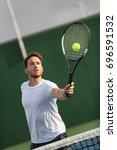 tennis player man hitting... | Shutterstock . vector #696591532