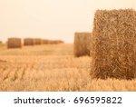 hay barrels on field after...   Shutterstock . vector #696595822