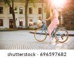 pretty smiling girl in dress... | Shutterstock . vector #696597682