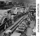 workers building cars in factory   Shutterstock . vector #696639136