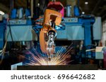 robot welding is welding... | Shutterstock . vector #696642682
