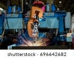 robot welding is welding... | Shutterstock . vector #696642682