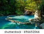 blue lagoon in front of scenic... | Shutterstock . vector #696652066