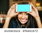 a smiling young indian woman... | Shutterstock . vector #696661672