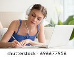 young woman in headphones... | Shutterstock . vector #696677956