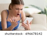 young woman feeling shocked and ... | Shutterstock . vector #696678142