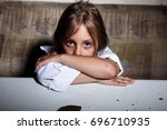 Stock photo child abuse poor child in slum begging you for help concept for poverty or hunger people 696710935